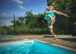 Person leaping into a swimming pool